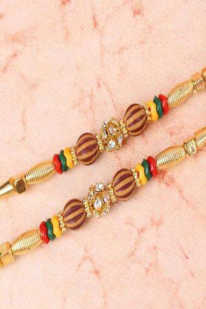Double Rakhi of Golden Design with Diamond Studded